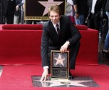 Film and television producer Jerry Bruckheimer poses with his star on the Hollywood Walk of Fame in Hollywood June 24, 2013.