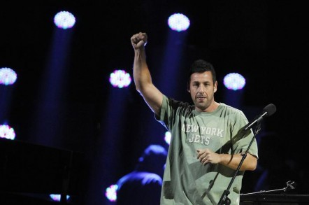 "Adam Sandler performs during the ""12-12-12"" benefit concert for victims of Superstorm Sandy at Madison Square Garden in New York December 12, 2012."