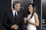 "Actors George Clooney and Sandra Bullock arrive for the film premiere of ""Gravity"" in New York October 1, 2013."
