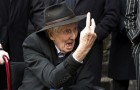 File photograph shows Great Train Robber Ronnie Biggs gesturing as he arrives for the funeral of Bruce Reynolds, at the church of St Bartholomew the Great in London March 20, 2013.