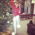 Mariah Carey posts a photo of husband Nick Cannon dancing in front of the family Christmas tree in 2012