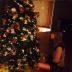Taylor Swift posing in front of a hotel room Christmas tree, 2013
