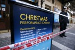 A police officer stands on duty next to a notice board is wrapped in police tape outside the Apollo theatre on the morning after part of it's ceiling collapsed on spectators as they watched a performa
