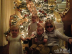 Tori Spelling and Dean McDermott's kids in front of the Christmas Tree