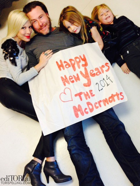 Tori Spelling, Dean McDermott and two of their children ringing in the New Year together