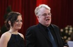 "Philip Seymour Hoffman (R), best supporting actor nominee for ""Charlie Wilson's War"", arrives with his girlfriend Mimi O'Donnell at the 80th annual Academy Awards, the Oscars, in Hollywood February 24"