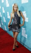Socialite Paris Hilton poses as she arrives at the 2012 MTV Movie Awards in Los Angeles, June 3, 2012.