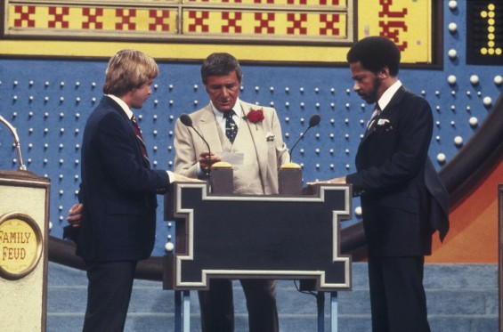 "Actor and television game show host Richard Dawson (C) is seen during an episode of ""Family Feud"", in this undated handout photo supplied by the Game Show Network (GSN) on June 3, 2012. Best known for his work on the game show ""Family Feud&"