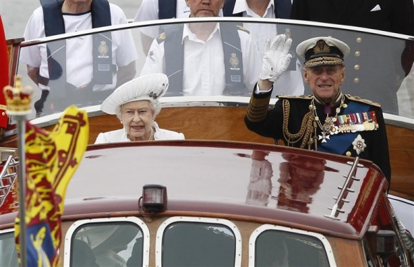 Britain's Queen Elizabeth and Prince Philip lead a pageant in celebration of the Queen's Diamond Jubilee along the River Thames in central London June 3, 2012.