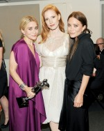 Jessica Chastain with womenswear designers of the year Mary Kate & Ashley Olsen.