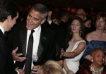 Actor George Clooney (2nd L) talks before the White House Correspondents' Association annual dinner in Washington April 28, 2012.