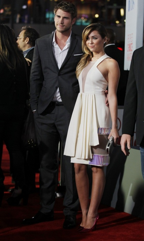 Australian actor Liam Hemsworth and singer Miley Cyrus arrive at the 2012 People&#039;s Choice Awards in Los Angeles January 11, 2012. 