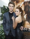 Cast member Miley Cyrus and co-star Liam Hemsworth pose at the premiere of &#034;The Last Song&#034; at the Arclight theatre in Hollywood, California March 25, 2010. 