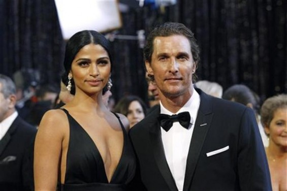 Actor Matthew McConaughey and his partner Camila Alves arrive at the 83rd Academy Awards in Hollywood, California, February 27, 2011.