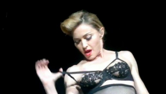 Madonna flashes her breast
