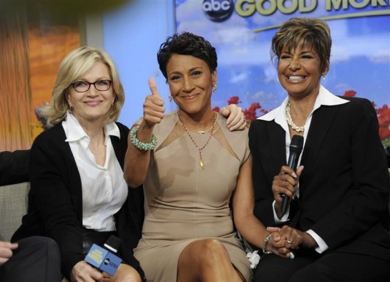 Robin Roberts (C) gives a thumbs up as she discusses her medical condition with Diane Sawyer (L) and Sally Ann Roberts on ABC&#039;s &#034;Good Morning America&#034; program in this handout photo released June 11, 2012.