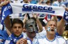 Greece soccer fans cheers as wait for start of Euro 2012 soccer match against Czech Republic in Wroclaw