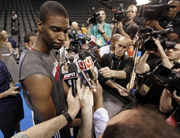 Miami Heat's Chris Bosh speaks with the media as the Miami Heat get ready to play the Oklahoma City Thunder in the NBA Finals series in Oklahoma City June 11, 2012.