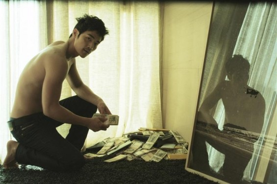"Actor Kim Kang-woo who plays the role of Joo Young-jak in the movie ""Taste of Money"", or ""Do-Nui Mat"", is seen in this undated still picture, from the movie, released in Seoul June 11, 2012. The raw and gritty movie, which was in competition at"