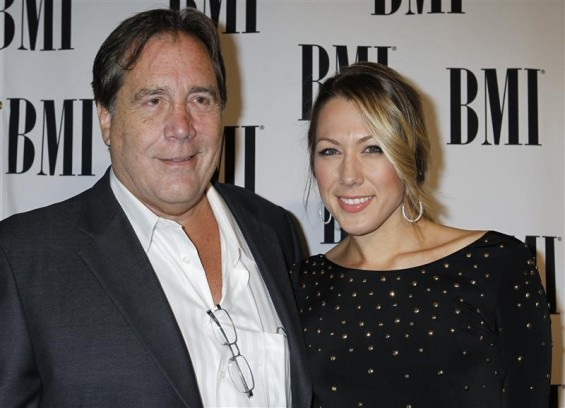 Singer and songwriter Colbie Caillat arrives with her father Ken Caillat at the 59th Annual BMI Pop Awards in Beverly Hills, California May 17, 2011.