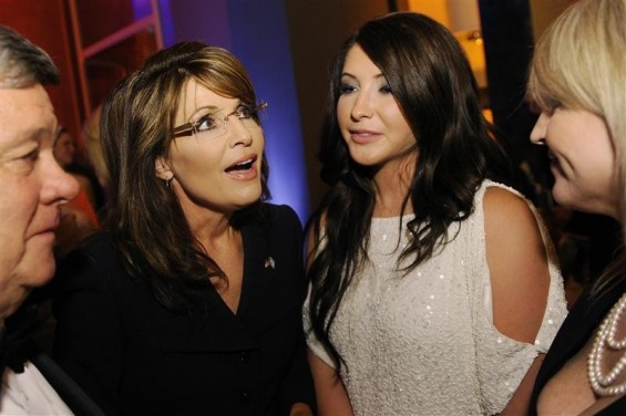 Former Governor of Alaska Sarah Palin (2nd L) talks with her daughter Bristol Palin (2nd R) as she arrives at the embassy of Italy for an MSNBC after-party following the annual White House Correspondents' Association dinner in Washington May 1, 2011.