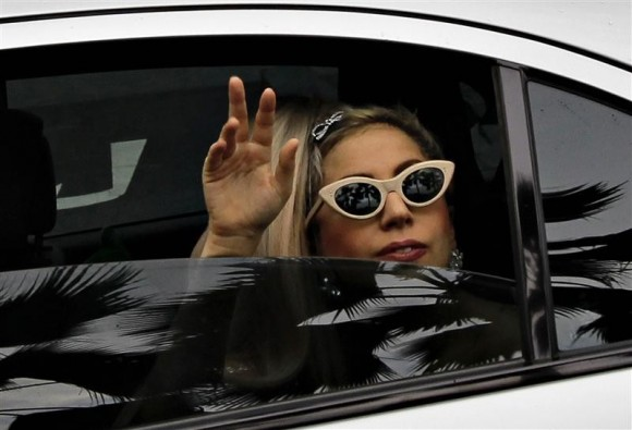 U.S. singer Lady Gaga waves to fans upon arriving at the JetQuay CIP (Commercially Important People) terminal at Changi Airport in Singapore May 26, 2012.
