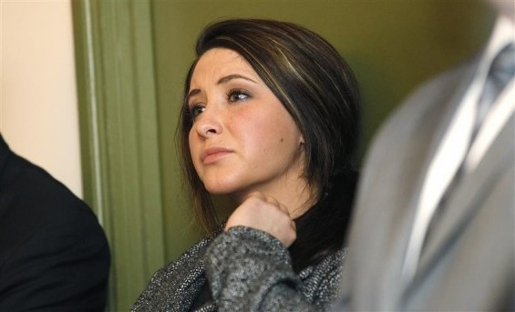 Bristol Palin watches while her mother former Alaska governor Sarah Palin delivers her keynote speech at the Reagan 100 opening banquet at the Reagan Ranch Center in Santa Barbara, California February 4, 2011.