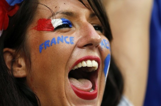 A fan of France cheers before their Group D Euro 2012 soccer match against Ukraine at Donbass Arena in Donetsk June 15, 2012. REUTERS/