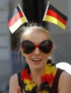 A Germany soccer fan smiles in central Lviv June 17, 2012. Germany will play against Denmark in their next Euro 2012 soccer group stage match in Lviv later today.