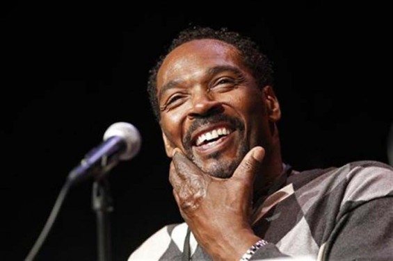"Rodney King smiles during a discussion for his memoir entitled ""The Riot Within: My Journey from Rebellion to Redemption"" at the Los Angeles Times Festival of Books on the campus of the University of Southern California in Los Angeles April 21,"