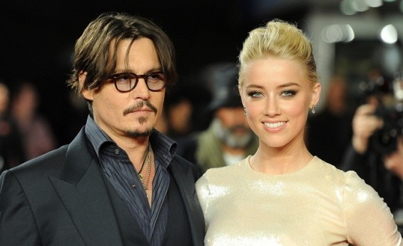 Johnny Depp and Amber Heard pose for photographers as they arrive for the European premiere of 'The Rum Diary', London, November 3, 2011.