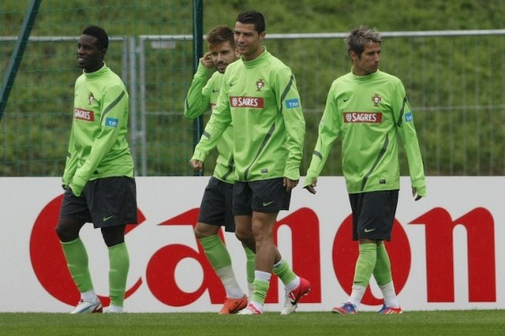 Portugal's Silvestre Varela (L-R), Miguel Veloso, Cristiano Ronaldo and Fabio Coentrao attend a training session during the Euro 2012 at Opalenica stadium in Opalenica June 20, 2012.