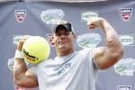 Wrestler John Cena poses for photographers during 'Arthur Ashe Kid's Day' at the U.S. Open in Flushing, New York August 25, 2007.
