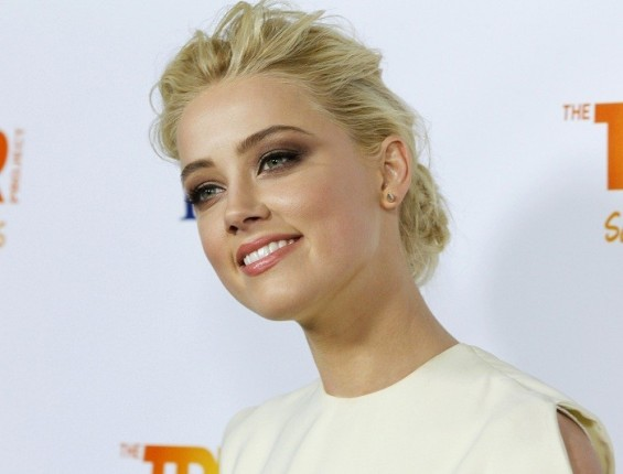 Actress Amber Heard arrives at The Trevor Project&#039;s &#034;Trevor Live&#034; fundraising dinner in Hollywood, California December 4, 2011. The Trevor Project provides crisis intervention and suicide prevention services to lesbian, gay, bisexual and tr