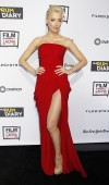 Actress Amber Heard poses at the premiere of her new film &#034;The Rum Diary&#034; hosted by Film Independent at the Los Angeles County Museum of Art (LACMA) in Los Angeles October 13, 2011.