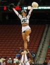 A cheerleader performing at a basketball game