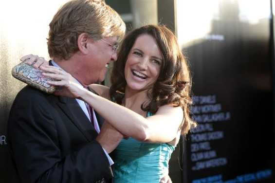 Creator and executive producer Aaron Sorkin and actress Kristin Davis pose at the premiere of the HBO television series &#034;The Newsroom&#034; at the Cinerama Dome in Los Angeles, California June 20, 2012.