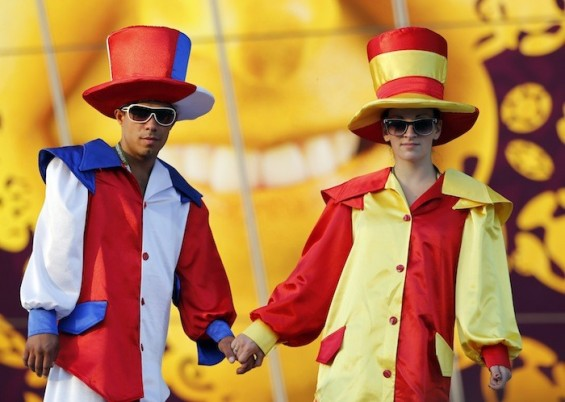 Soccer fans, dressed in French and Spanish costumes, holding hands outside the Donbass Arena before the Euro 2012 quarter-final match