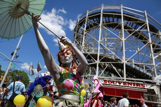People take part in the Mermaid Parade at Coney Island in the Brooklyn section of New York June 23, 2012.