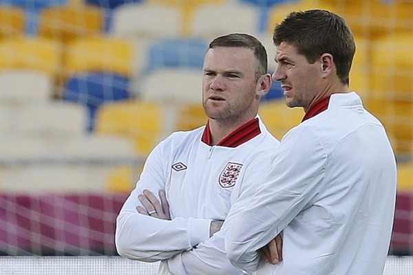 England's soccer players Steven Gerrard (R) and Wayne Rooney attend a training session at the Olympic Stadium in Kiev, June 23, 2012.
