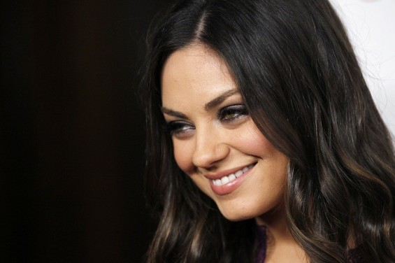 Cast member Mila Kunis poses at the premiere of &#034;Ted&#034; at the Grauman&#039;s Chinese theatre in Hollywood, California June 21, 2012. The movie opens in the U.S. on June 29.