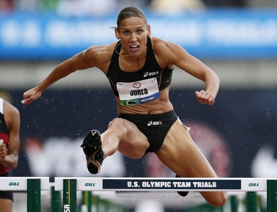 Hurdler Lolo Jones competes in the first round of qualifying for the women's 100 meter hurdles at the U.S. Olympic athletics trials in Eugene, Oregon, June 22, 2012.