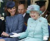 Britain's Catherine, Duchess of Cambridge (L) laughs as Queen Elizabeth gestures while they watch part of a children's sports event during a visit to Vernon Park in Nottingham, central England, June 13, 2012.