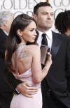 Actress Megan Fox (L) and actor Brian Austin Green arrive at the 68th annual Golden Globe Awards in Beverly Hills, California January 16, 2011. REUTERS