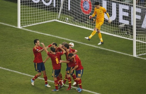 Spain&#039;s players celebrate their second goal next to France&#039;s goalkeeper Hugo Lloris during their Euro 2012 quarter-final soccer match at the Donbass Arena in Donetsk, June 23, 2012.