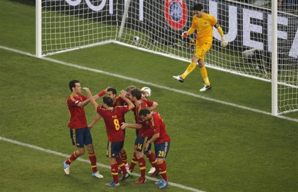 Spain's players celebrate their second goal next to France's goalkeeper Hugo Lloris during their Euro 2012 quarter-final soccer match at the Donbass Arena in Donetsk, June 23, 2012.