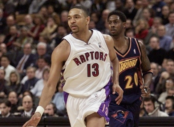 Toronto Raptors Mark Jackson (L) now Warrior's coach, dribbles up court followed by Golden State Warriors' Larry Hughes during the fourth period in Toronto February 20, 2001.