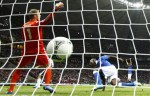 Italy's Mario Balotelli (R) scores a goal against Germany's goalkeeper Manuel Neuer during their Euro 2012 semi-final soccer match at the National stadium in Warsaw, June 28, 2012.