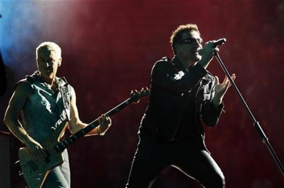 Lead singer Bono of Irish rock band U2 performs with Adam Clayton (L) during their 360 Degree Tour at King Baudouin Stadium in Brussels September 22, 2010.