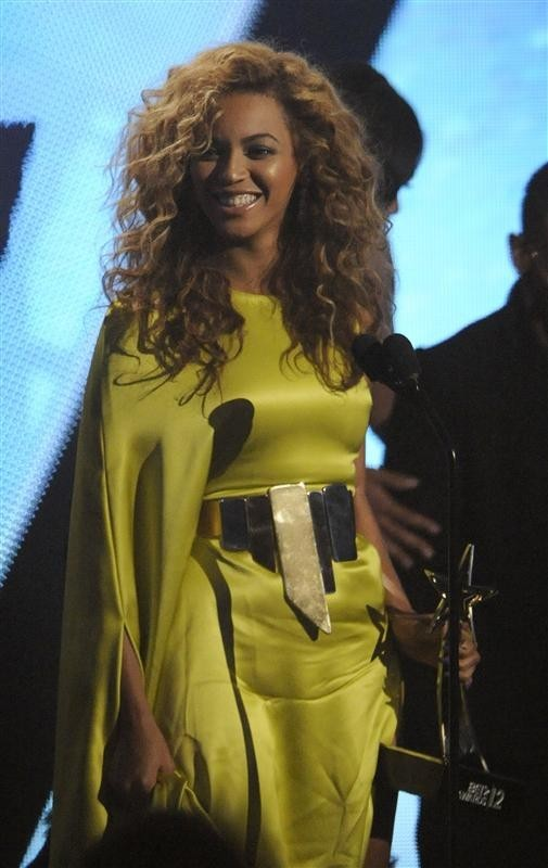 Beyonce Knowles accepts her award for best R&B artist at the 2012 BET Awards in Los Angeles on July 1, 2012.